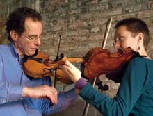 Bruce Sagan and lydia ievins playing fiddles